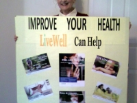 WCV-Jo-with-her-LiveWell-information-poster