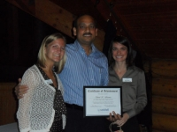 northern-region-volunteer-of-the-year-sunil-sharma-stands-next-to-coordinators-michelle-and-sarah