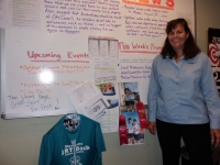volunteer-kim-zuanich-uses-photos-and-shirts-to-draw-people's-attention-to-the-health-events-happening-in-her-area
